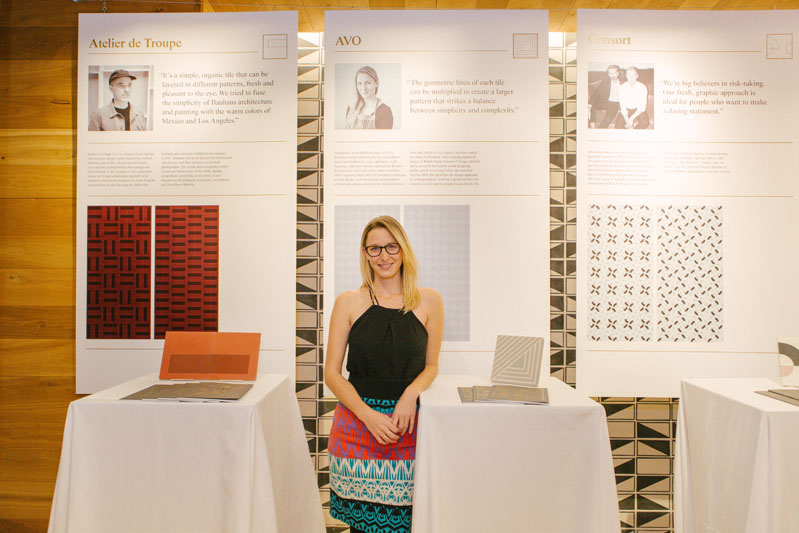 Brit Kleinman of AVO in front of her tile design