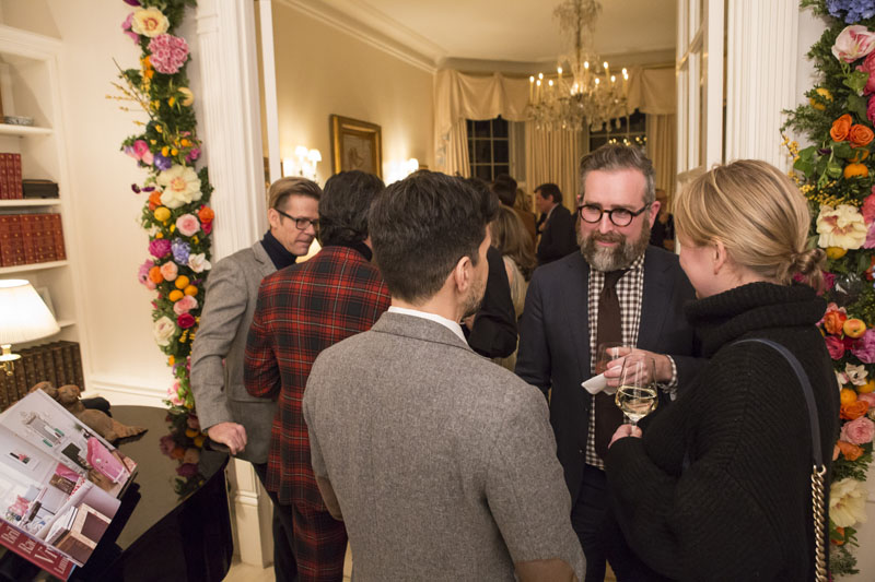 Guests mingling during the party