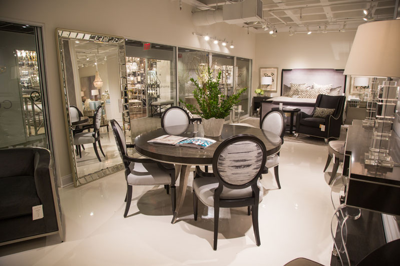 Custom Caracole couture product selections were featured in the Caracole showroom; shown here are customized Chit-Chat arm chairs surrounding the Table Dance table.