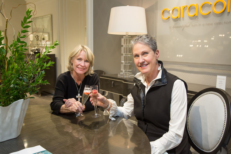 Caracole customers enjoying a toast with bubbly