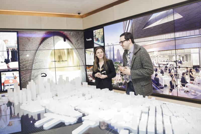 Guests view the Hudson Yards model.