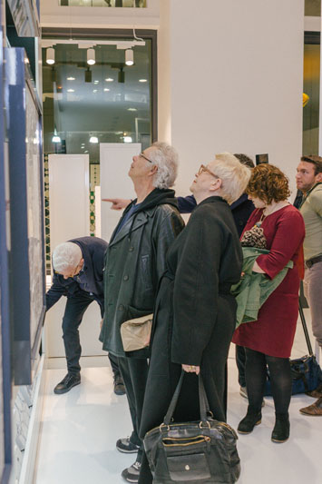Guests view the tile collection.