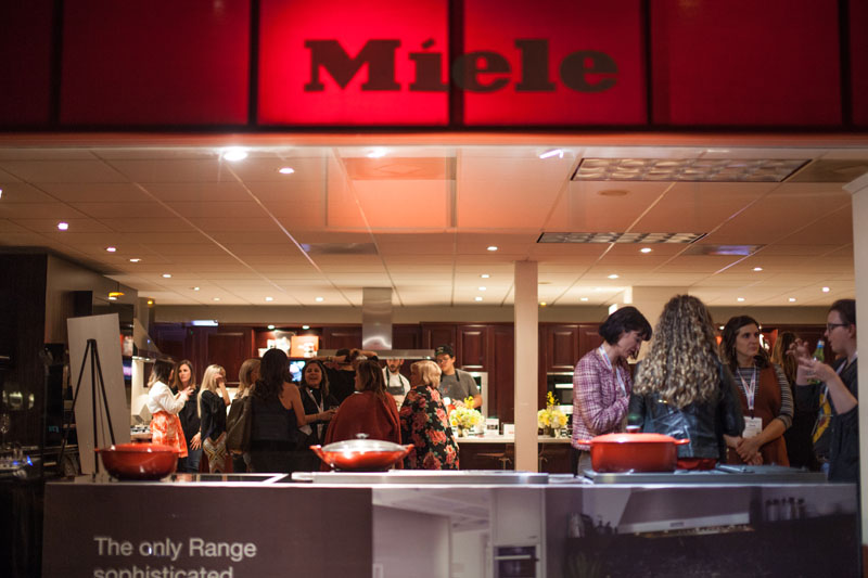 Design Blogger attendees mixing and mingling in the Miele showroom