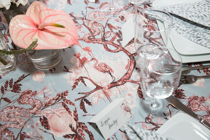 Ferrick Mason's new Good Fortune fabric displayed on napkins and tablecloth