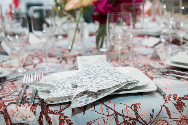 Ferrick Mason fabric displayed on napkins and tablecloth