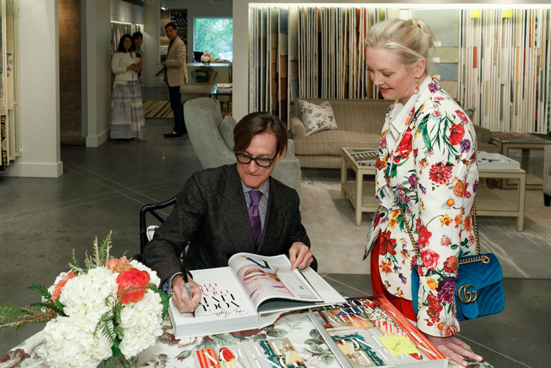 Hamish Bowles signs his latest book, 'Vogue Living: Country, City, Coast' for designer Danielle Rollins.