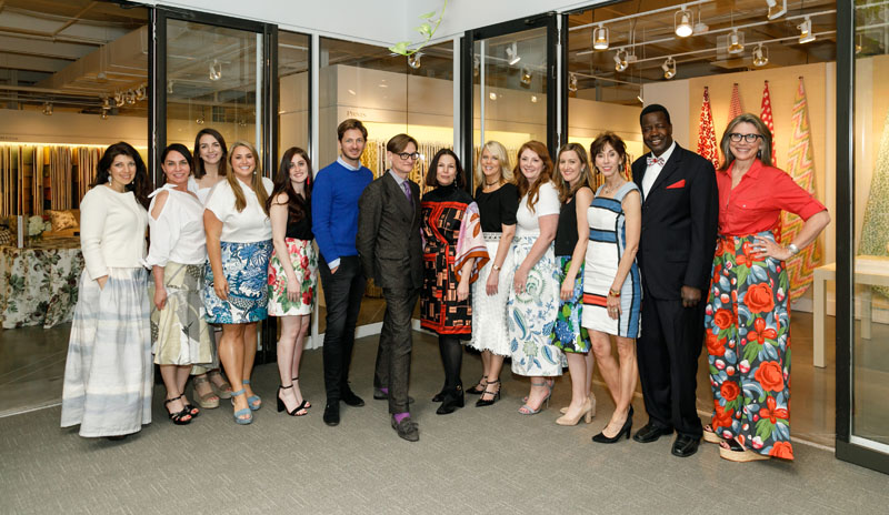 Hamish Bowles poses with Schumacher president Benni Frowein and creative director Dara Caponigro and the Atlanta Showroom team, whose skirts (and one bow tie) were handmade from materials at Schumacher.