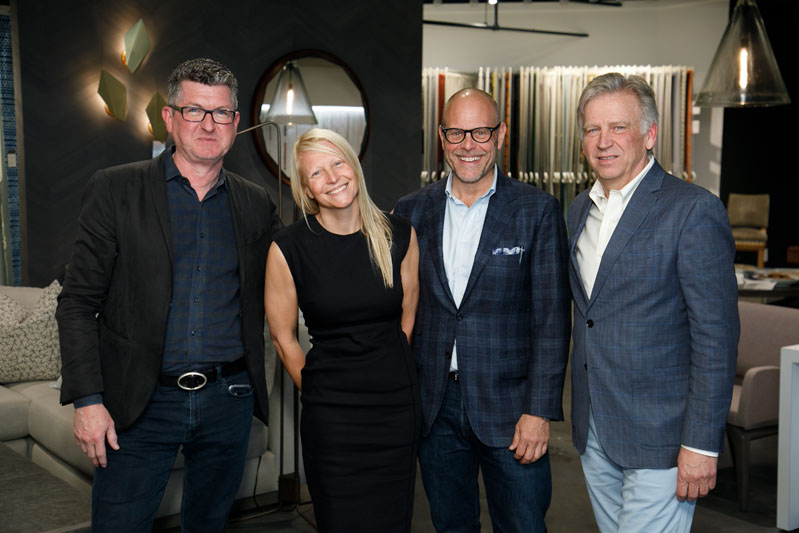 Designers Patrick Sutton and Elizabeth Ingram; chef, television personality, and moderator Alton Brown; and architect Steven Rugo enjoy a reception at the Paul+ showroom following their 'Take Out: Bring Restaurant Design Home' panel discussion.