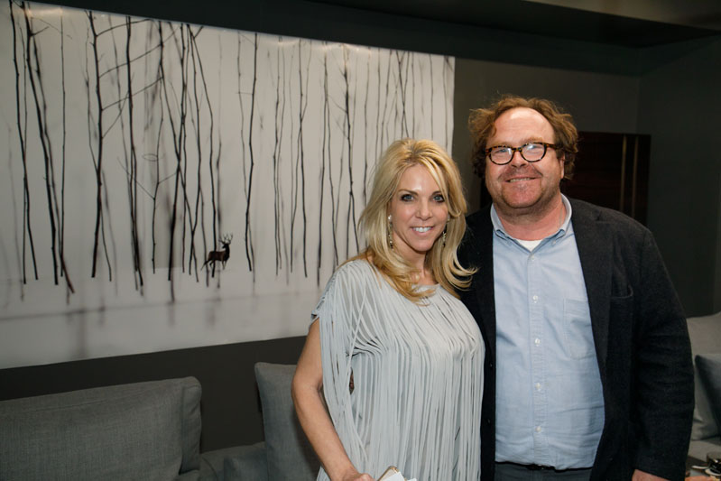 Showroom co-owner Jennifer Astrop and artist Todd Murphy pose in front of one of his featured works at the 'Todd Murphy: A Solo Exhibition' in the Minotti by HA Modern showroom during Design ADAC.