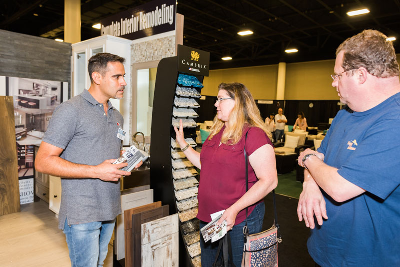 An attendee discusses samples in the Cambria booth.