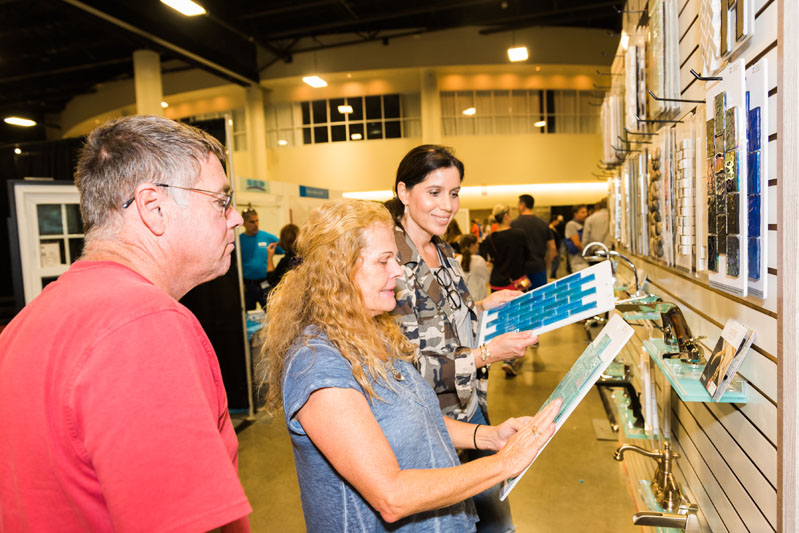 Show attendees examine tile samples.