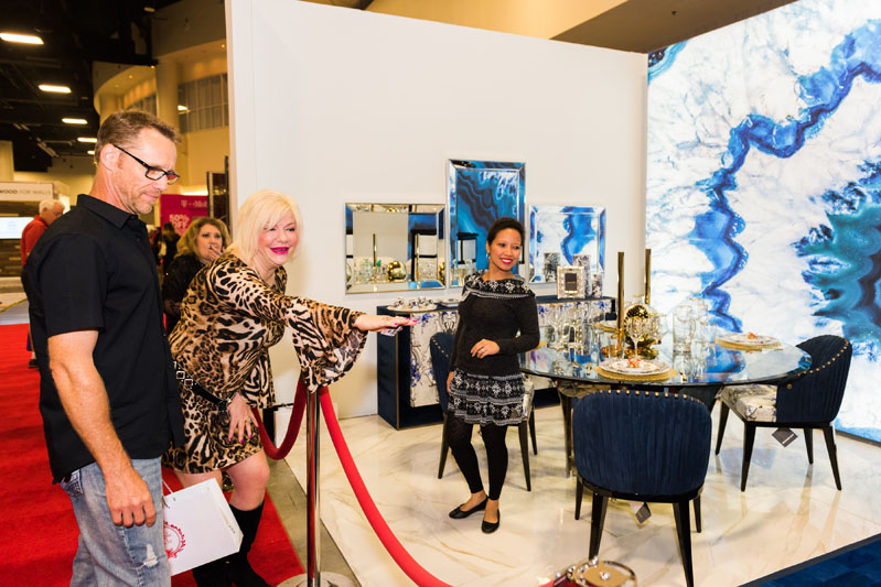 Attendees gush over Perla Lichi's designed room, titled 'Modern Fusion Magic.'