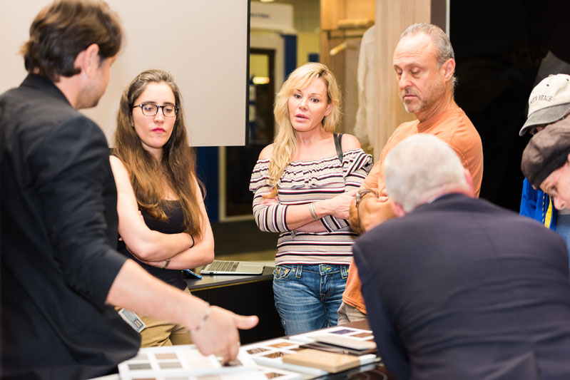 Attendees listen to an exhibitor's demonstration.