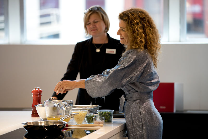 Jordana Joseph gives a cooking demonstration for the crowd, assisted by Tracy Parks.
