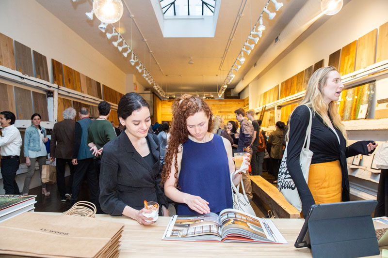 Karin Honarvar and Natalie LaBossier flip through Clodagh's book, 'Clodagh: Life-Enhancing Design.'