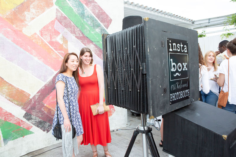 Guests interacting with a photobooth.