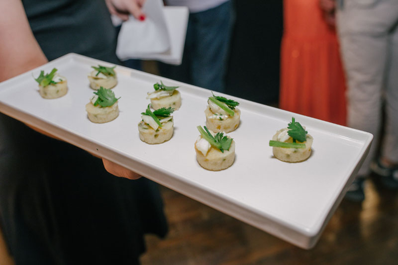 Guests snack on hors d'oeuvres.