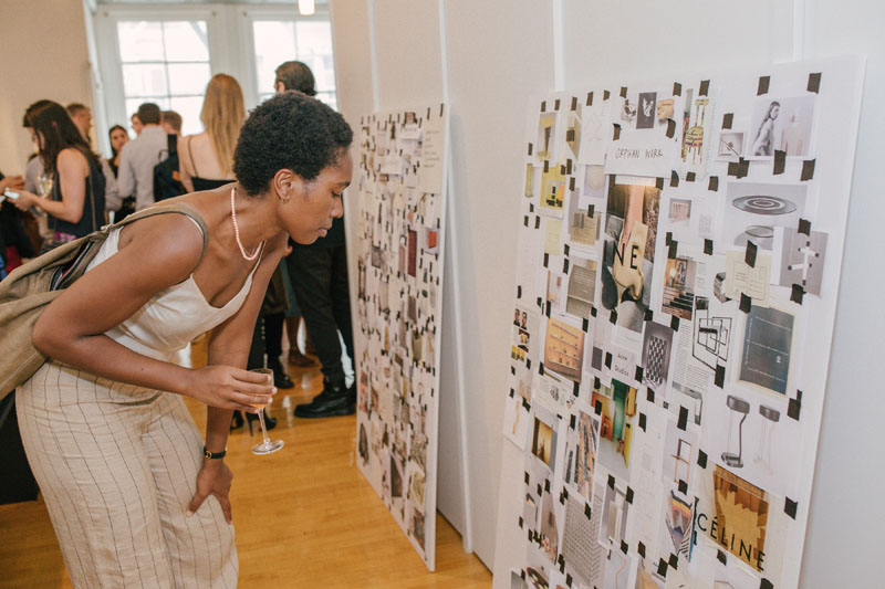 A guest studies the inspiration board.