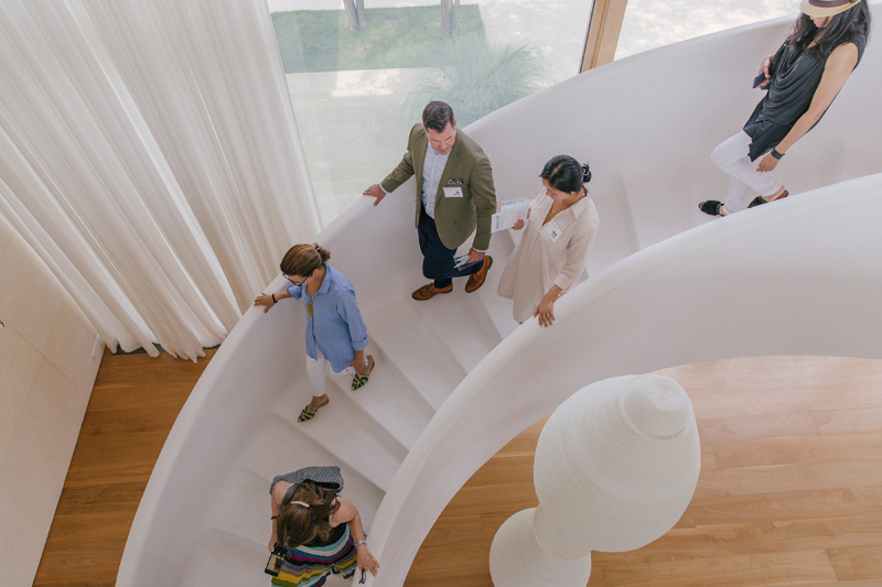 Guests descend Kelly Behun's staircase.