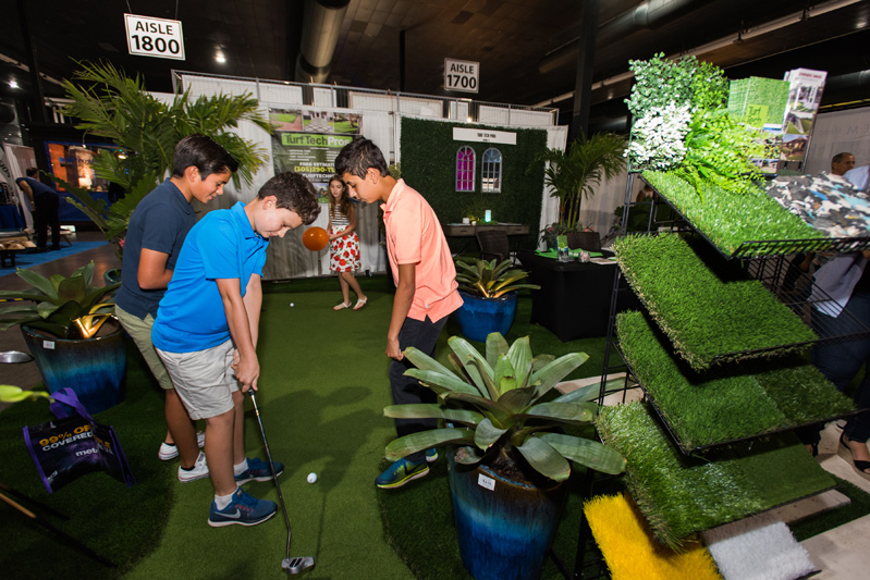 Guests enjoy Turf Tech Pros's display.