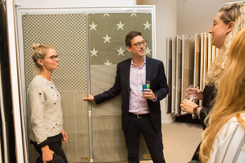 Chad Stark shows off samples in the newly reimagined trade showroom.