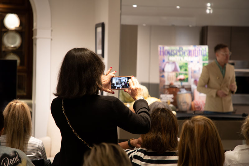 An attendee snaps a photo of Ross's presentation.
