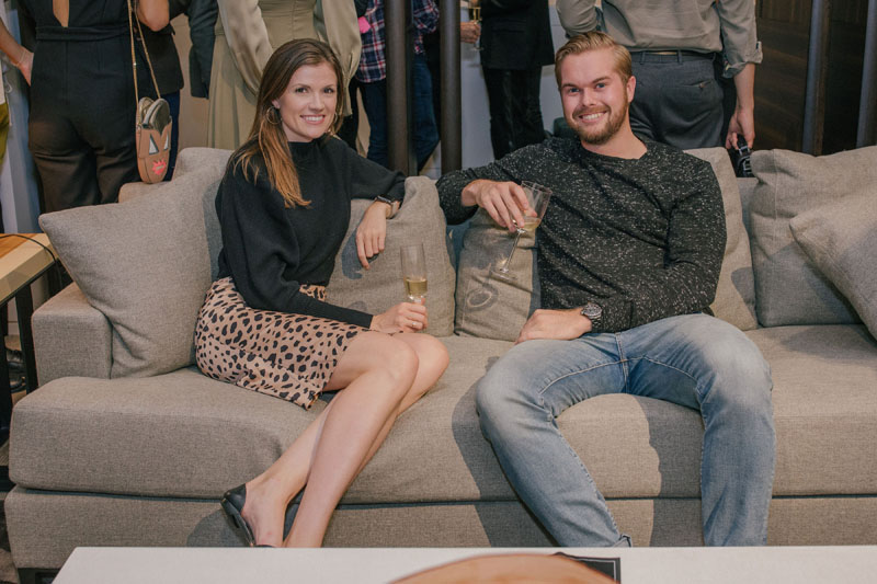 Dillon Harding of Chanel (right) tests out a Liaigre sofa with a pal.