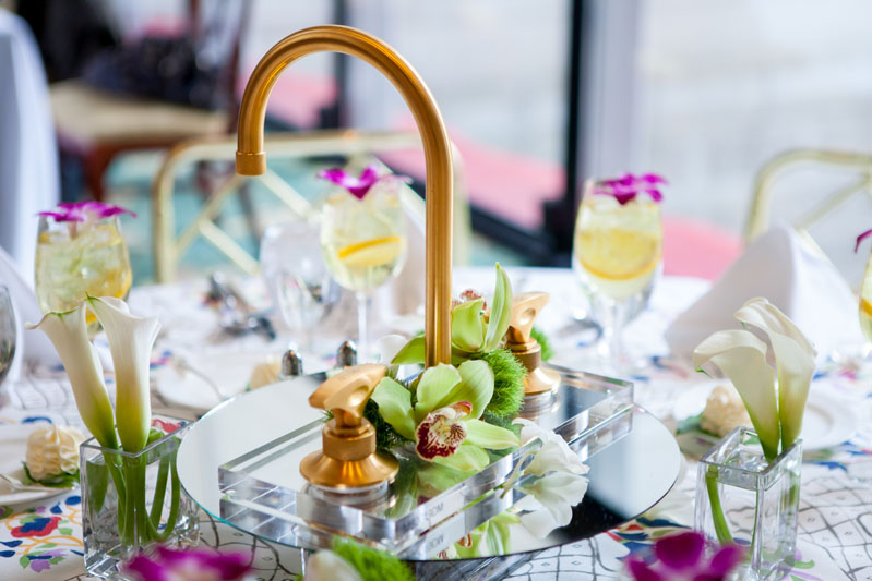 Table centerpieces featured custom linens from Mally Skok Design paired with various Rohl faucets.
