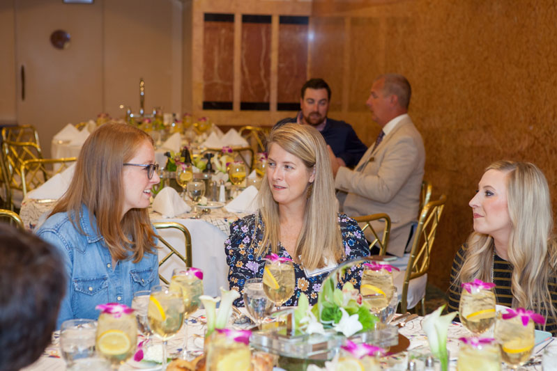 Guest panelist Annsley McAleer (center) talks with guests during the luncheon at the Rohl Auth Lux Summit in Boston.