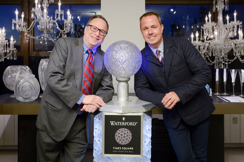 Jeffrey Straus and Michael Craig pose with the Waterford Times Square Crystal Ball podium.