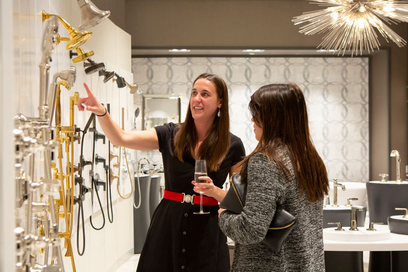 Guests, including Sarah Fitzsimmons (left), had a chance to interact with the Kohler product.