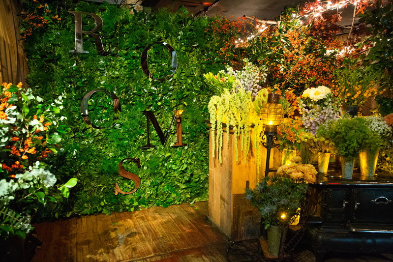 The restaurant was festooned with a greenery wall.