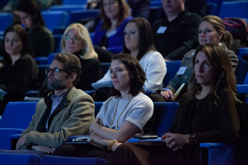 Members, including Mike Gracie, Angela Jett and Julia Noran Johnston, listened attentively.