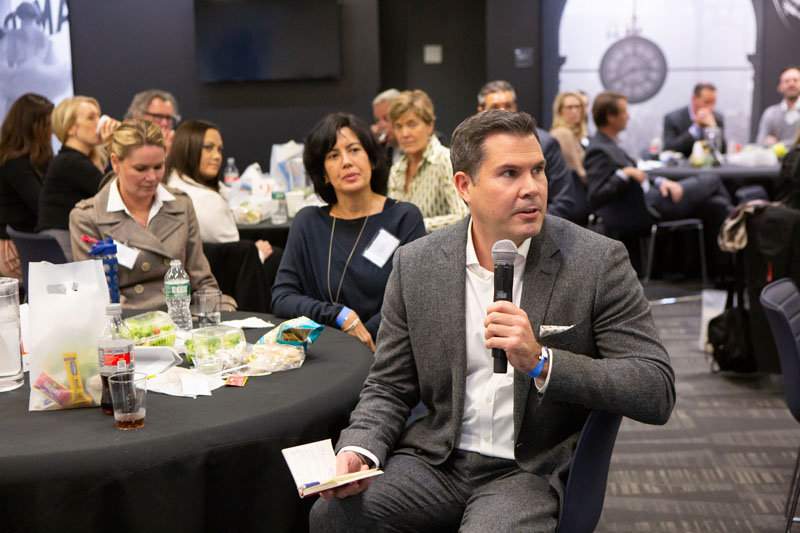 Jon Walker of Hearst Design Group shares his table's findings with the group