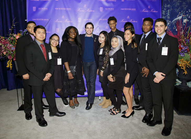 The evening's honorary chair Zac Posen with East Side House Students