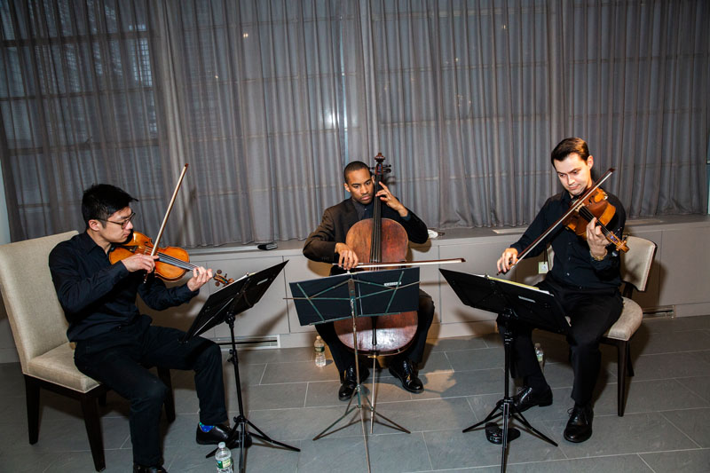 A Julliard trio entertained guests