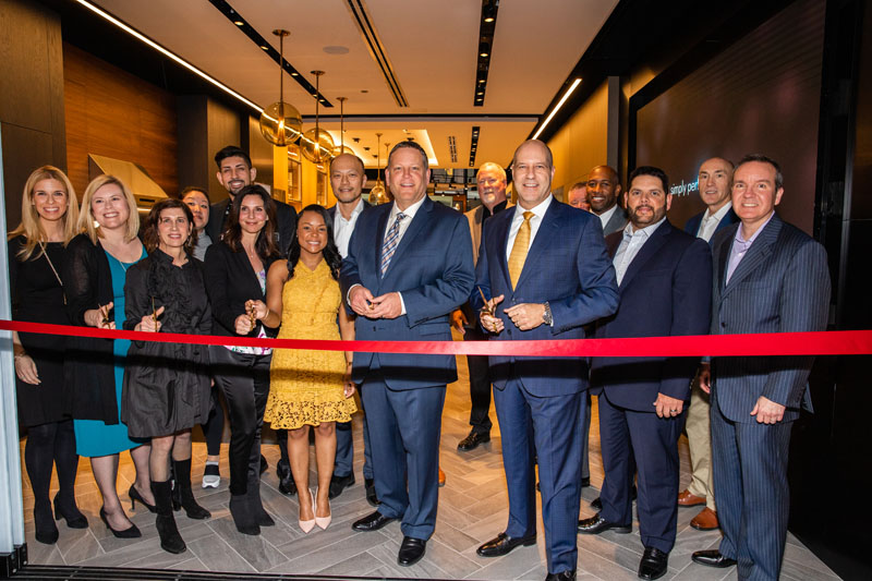 The Dacor executive team, with members of the Mart team, cut the ribbon to the new Dacor Kitchen Theater Chicago.
