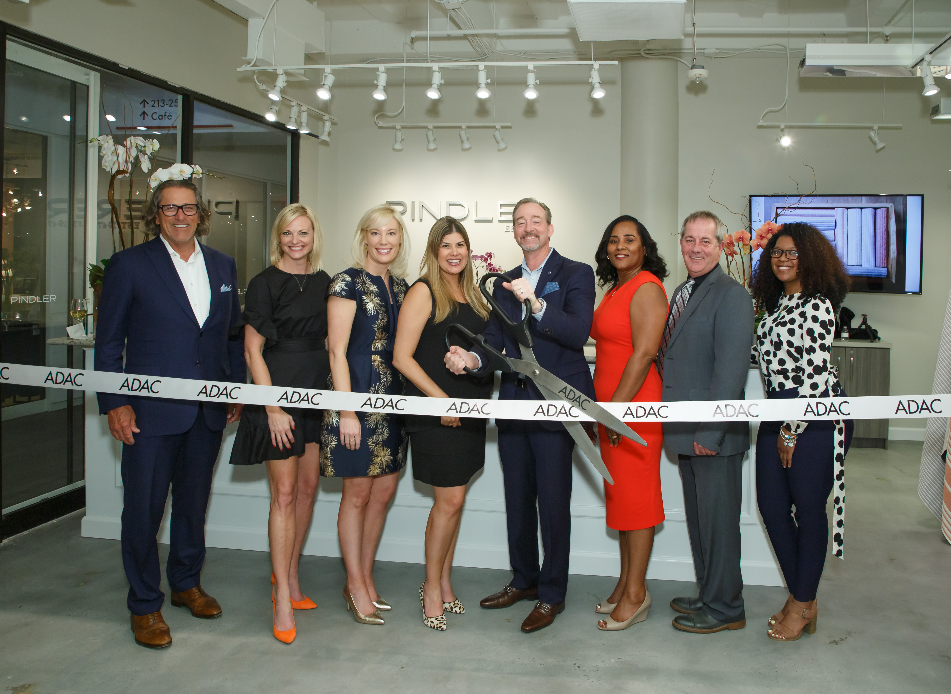 The Pindler team, with Bob Maricich and Katie Miner, celebrated the Pindler grand reopening with a ribbon cutting.