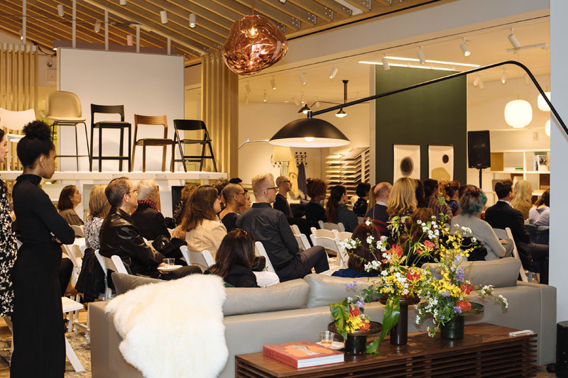 Guests listen to Dennis Scully and Wendy Goodman in conversation.