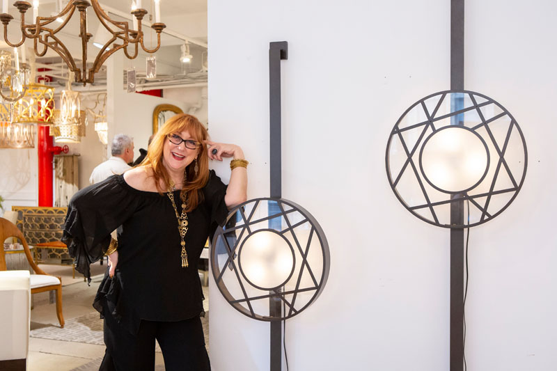 Robin Baron poses with her new Icon Sconce