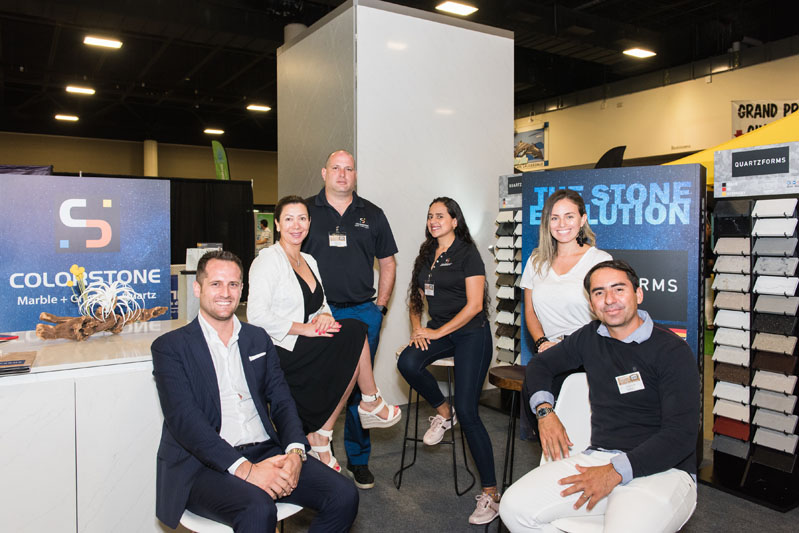 The team from Colorstone smiles in their booth.