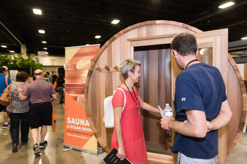 Guests check out a portable sauna.