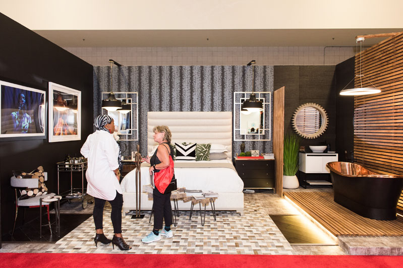 Nicole White, a Home Show featured designer, greets guests.