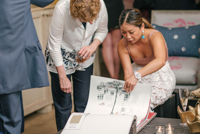 Designer Peti Lau peruses the new collection.