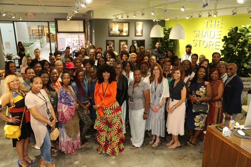 'Cheese!' Attendees of Thursday's luncheon at The Shade Store pose for a group photo.