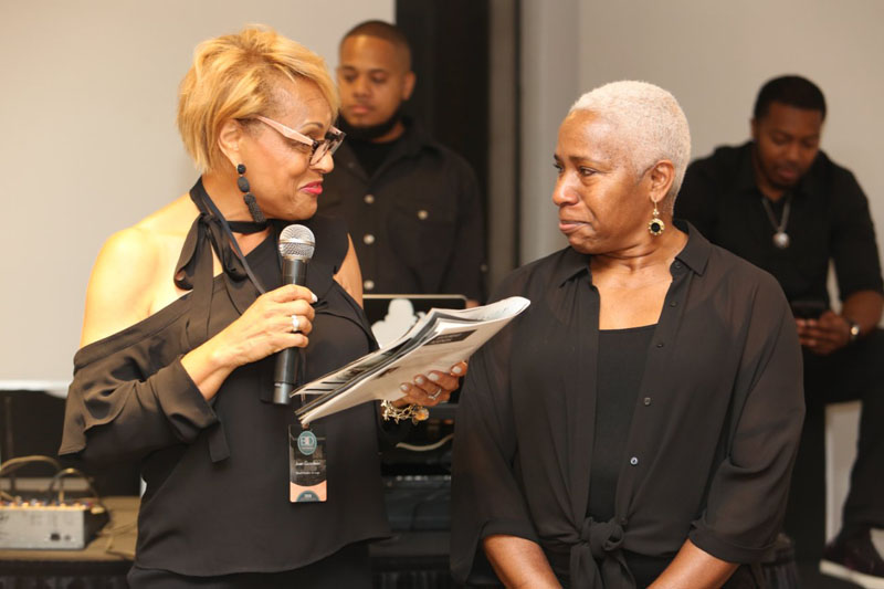 BIDN executive board member Joan Goodwin presents Curated Home Brands president Katrena Griggs with the Kimberly E. Ward 2019 Design Icon Award.
