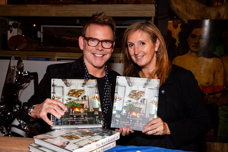 Jeff Andrews poses with a guest and their copies of 'The New Glamour: Interiors With Star Quality.'
