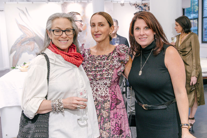 Pam Sommers, director of public relations at Rizzoli (left), and her associate Jessica Napp flank New York–based publicist Christina Juarez.