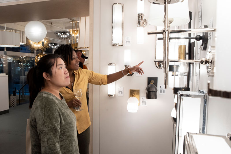 Guests browse new products from Circa Lighting on display during What's New What's Next.