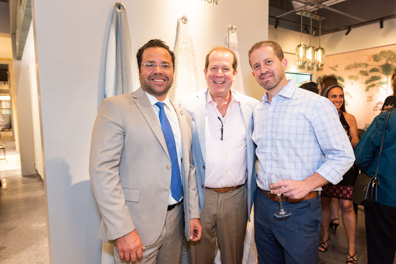 Scott Kravet (center), with City of Hollywood mayor Josh Levy and economic development manager Herbert Conde-Parlato